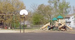 Basketball court, swingset, and playground at Friendship Park